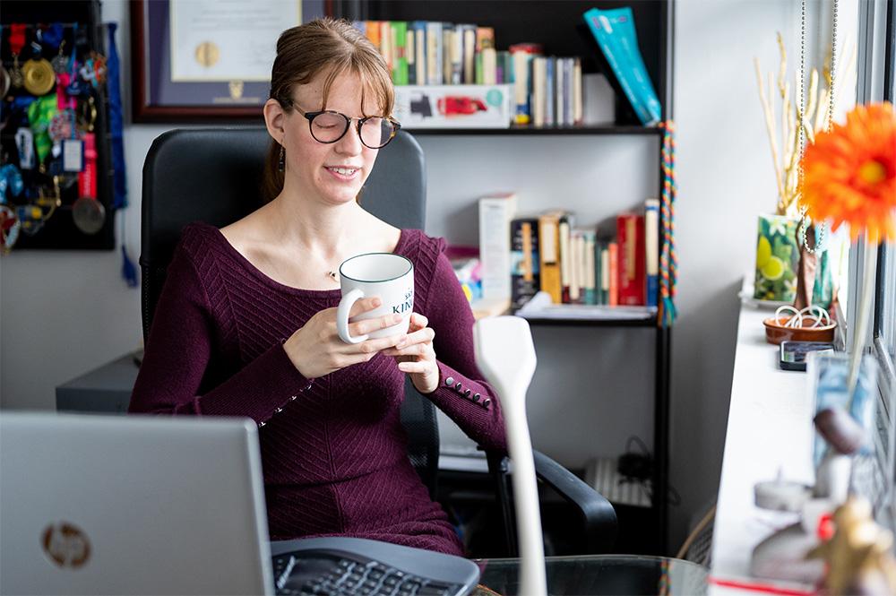Elizabeth Mohler sitting at the computer