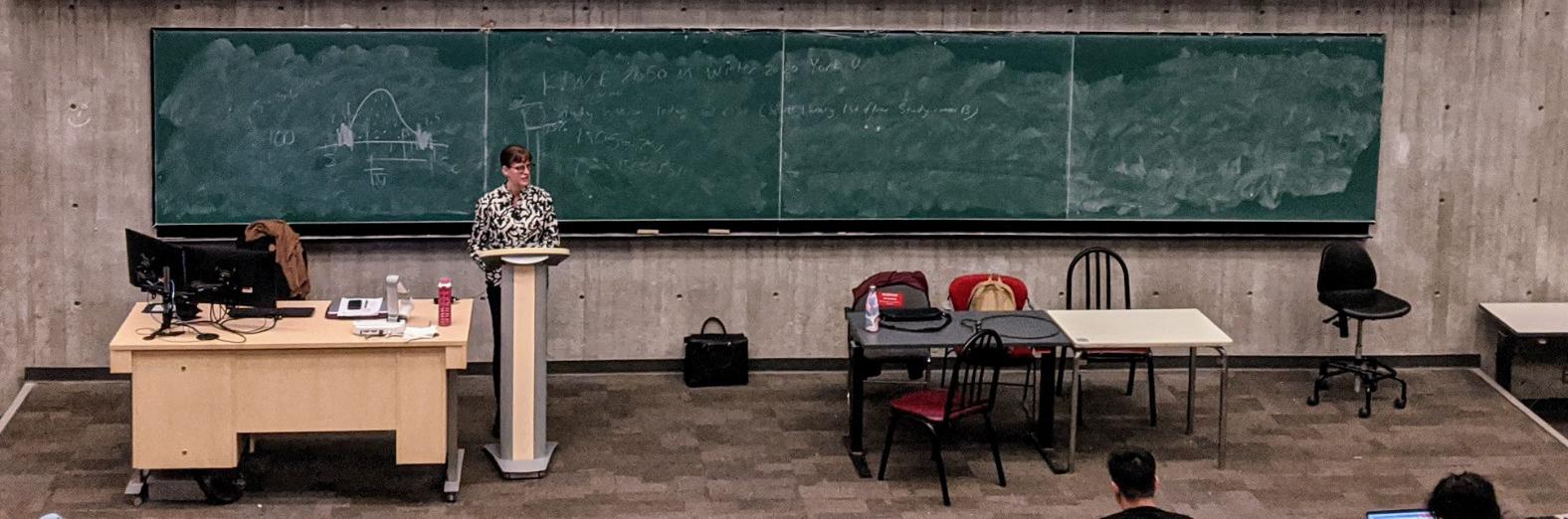Elizabeth presenting in a University auditorium
