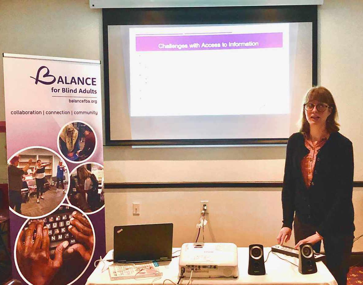 Elizabeth presenting to audience