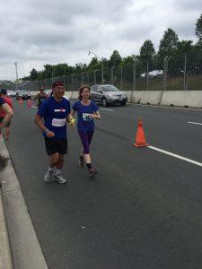 Elizabeth completing a marathon at the finish line